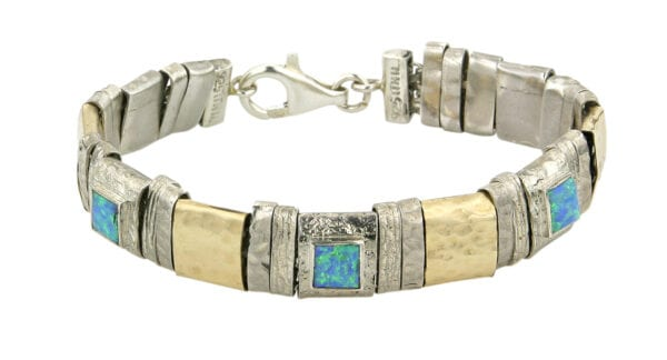 Elegant and classic. This beautiful bracelet made from 925 sterling silver, combined with 14k rolled gold with a hammered texture, set with opalite. Approximate length 20cm.