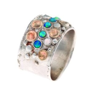 Dazzling silver and gold ring with gems