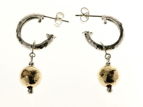 Handmade hammered sterling silver loop earrings with 14k rolled gold drop detail