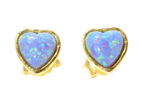 Lovely sterling silver with 24k gold plate studs set with heart shaped opalite gems