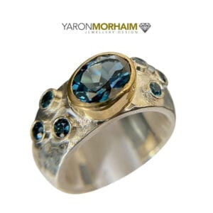 Ring Swiss Blue Topaz. Beautiful sterling silver and 9k solid gold ring set with Swiss Blue Topaz
